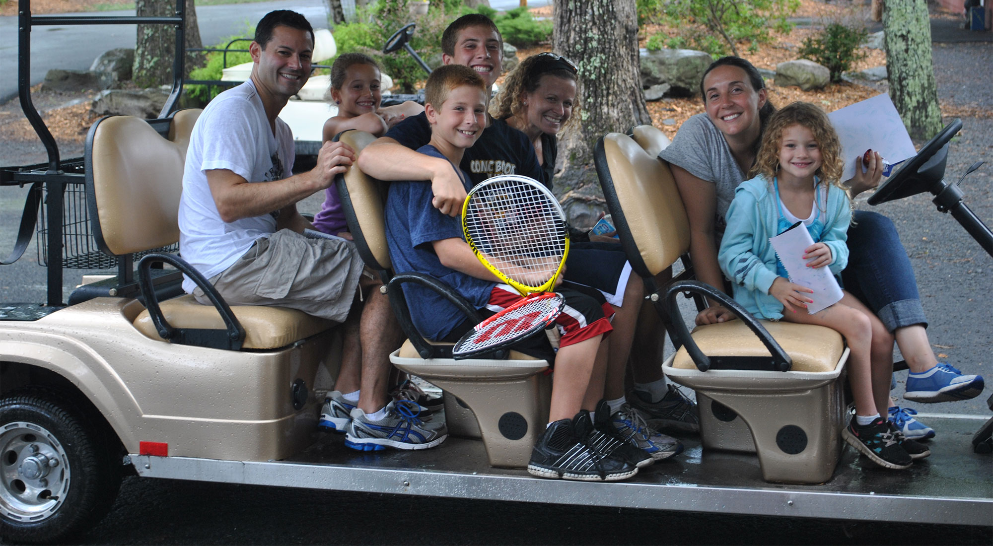 Image of happy campers taking tour of Camp Canadensis